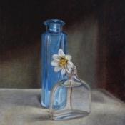 blauw-flesje-en-bloem